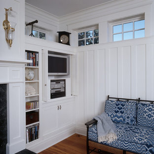 Coastal living room photo in Portland Maine with white walls and a media wall