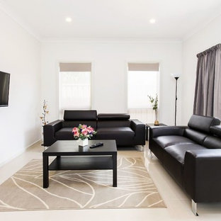 This is an example of a small traditional living room in Adelaide with white walls, ceramic floors, a wall-mounted tv and beige floor.