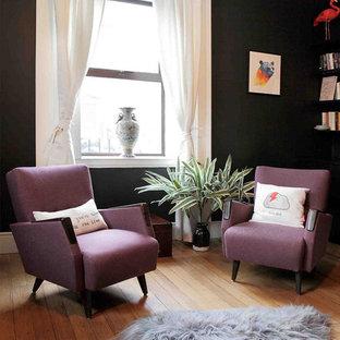 Foto på ett eklektiskt vardagsrum, med svarta väggar