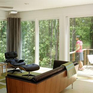 Foto di un soggiorno moderno di medie dimensioni con pareti bianche