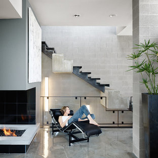 This is an example of a modern living room in Austin with concrete floors.
