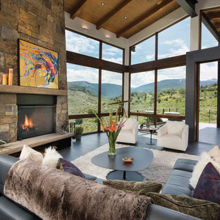 Example of a huge trendy open concept porcelain floor and gray floor living room design in Denver with white walls, a standard fireplace and a stone fireplace