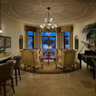 Example of a mid-sized classic enclosed limestone floor living room design in Phoenix with a music area, beige walls and no tv