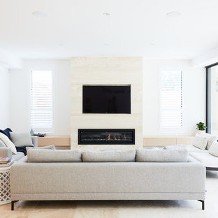 Inspiration for a contemporary living room in Sydney with white walls, a ribbon fireplace and a wall mounted tv.