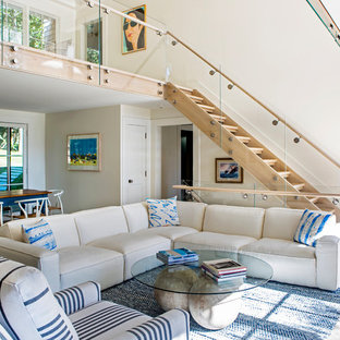 Inspiration for a beach style open concept medium tone wood floor and brown floor living room remodel in New York with white walls