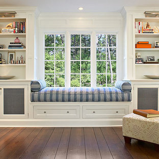 Inspiration for a mid-sized traditional enclosed living room in New York with a library, white walls and dark hardwood floors.