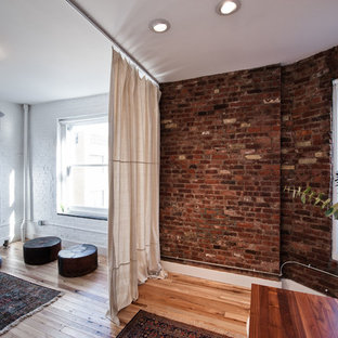Example Of A Trendy Medium Tone Wood Floor Living Room Design In New York