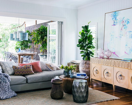 Tropical Open Concept Living Room In Melbourne With White Walls And Medium  Hardwood Floors.