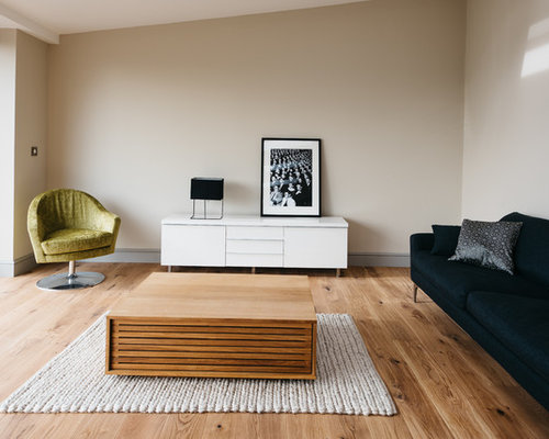 Contemporary Living Room In Cambridgeshire With Beige Walls, Medium  Hardwood Flooring, No Fireplace And
