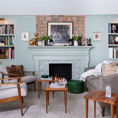 Inspiration for a mid-sized eclectic open concept light wood floor living room library remodel in New York with green walls, a standard fireplace, no tv and a tile fireplace