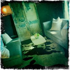 Eclectic Living Room Eclectic gray living room, vintage doors, modern couches, arc floor lamp.