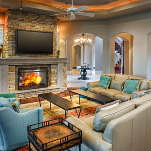 Living room - traditional living room idea in Austin with a two-sided fireplace and a wall-mounted tv