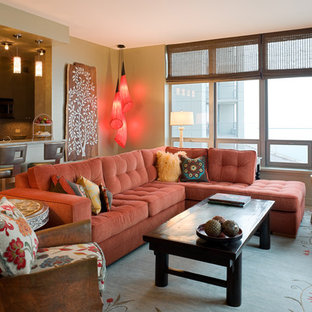 Example of a mid-sized eclectic formal and open concept light wood floor living room design in Chicago with a media wall and green walls