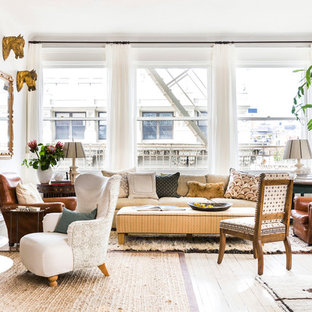 Living room - mid-sized eclectic formal and open concept painted wood floor and beige floor living room idea in New York with white walls and no tv