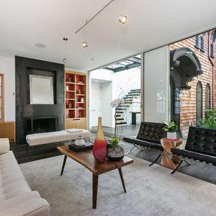 Trendy Dark Wood Floor And Brown Floor Living Room Photo In San Francisco  With White Walls