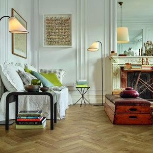 Ispirazione per un soggiorno boho chic di medie dimensioni con pareti bianche