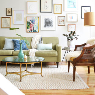 Inspiration for an eclectic light wood floor living room remodel in New York with white walls