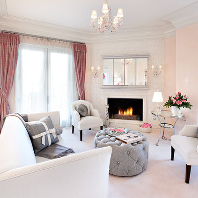 Living room - eclectic living room idea in Las Vegas with pink walls and a corner fireplace