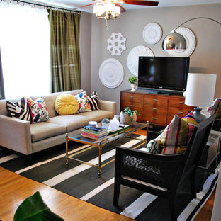 Living room - mid-sized eclectic medium tone wood floor living room idea in St Louis with gray walls and a tv stand