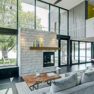 Idee per un soggiorno minimal con pareti grigie