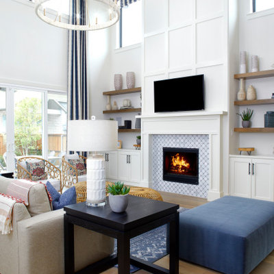 Living room - huge transitional open concept light wood floor, beige floor and wainscoting living room idea in Dallas with white walls, a standard fireplace, a tile fireplace and a wall-mounted tv