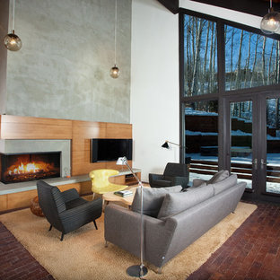 Trendy formal and open concept brick floor living room photo in Denver with white walls, a concrete fireplace, a wall-mounted tv and a ribbon fireplace