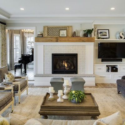 Inspiration for a timeless formal and enclosed medium tone wood floor living room remodel in Minneapolis with gray walls, a standard fireplace, a tile fireplace and a wall-mounted tv