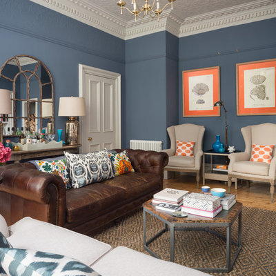 Example of a mid-sized transitional enclosed light wood floor and beige floor living room design in Edinburgh with blue walls