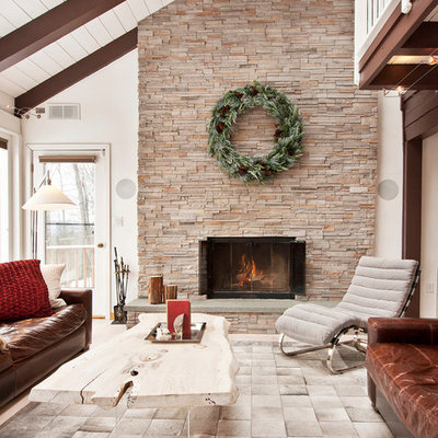 Example of a large mountain style formal and open concept living room design in New York with a standard fireplace, a stone fireplace and no tv