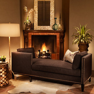 This is an example of a medium sized traditional formal enclosed living room in Seattle with brown walls, ceramic flooring, a standard fireplace, a tiled fireplace surround, no tv and red floors.