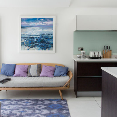 Mid-sized trendy open concept living room photo in London with white walls and no fireplace