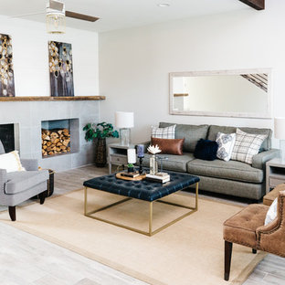 Mid-sized transitional formal and open concept porcelain floor and gray floor living room photo in Phoenix with gray walls, a two-sided fireplace and a tile fireplace