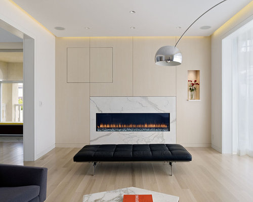 Modern Beige Floor Living Room Idea In San Francisco With Walls And A Ribbon Fireplace