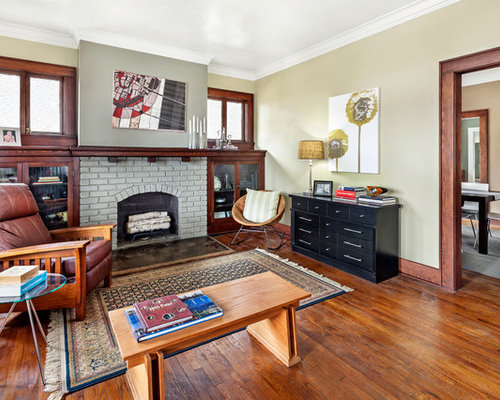 Large Transitional Medium Tone Wood Floor Living Room Photo In Other With A Brick Fireplace Surround