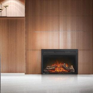 Modelo de salón para visitas cerrado, actual, de tamaño medio, sin televisor, con suelo de madera en tonos medios, marco de chimenea de metal, paredes beige, chimenea tradicional y suelo turquesa