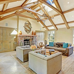 Inspiration for a large timeless enclosed linoleum floor living room library remodel in San Francisco with beige walls, a standard fireplace and a stone fireplace