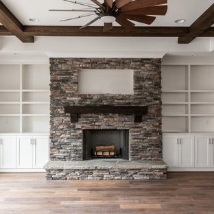 Inspiration for a craftsman open concept medium tone wood floor, exposed beam and shiplap wall living room remodel in Charlotte with beige walls, a wood stove and a stacked stone fireplace