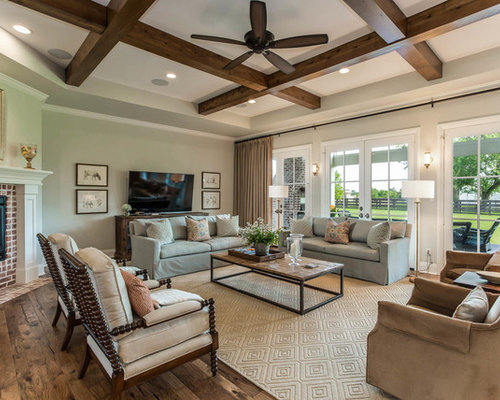 Country Open Concept Medium Tone Wood Floor And Brown Living Room Photo In Houston With