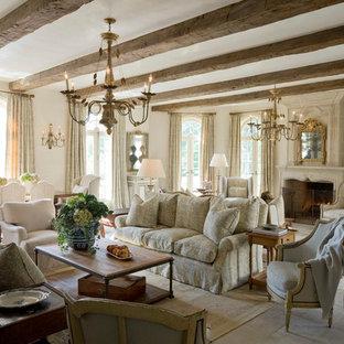 Idées déco pour un grand salon ouvert avec une salle de réception, un mur beige, une cheminée standard, un sol en ardoise, un manteau de cheminée en pierre et aucun téléviseur.