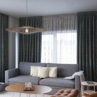 Esempio di un soggiorno nordico di medie dimensioni e chiuso con pareti bianche, pavimento con piastrelle in ceramica, parete attrezzata e pavimento blu