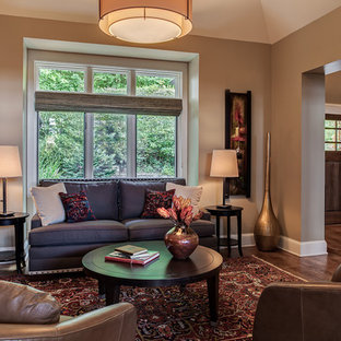 Inspiration for a contemporary living room in Other with brown walls and dark hardwood flooring.