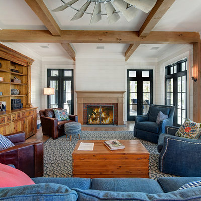 Example of a large beach style open concept medium tone wood floor and brown floor living room design in Baltimore with gray walls, a standard fireplace, a brick fireplace and no tv