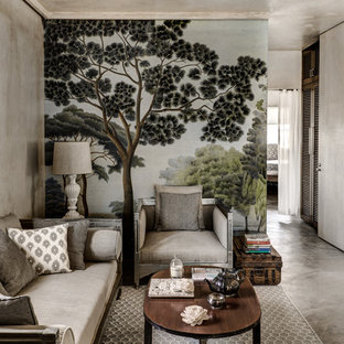 ムンバイの地中海スタイルのおしゃれなリビング (グレーの壁、コンクリートの床) の写真