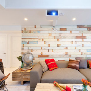 Inspiration for a beach style living room remodel in New York with multicolored walls