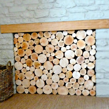 Empty Fireplace with Wood Mantle Filled WIth Display Logs