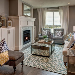 Inspiration for a transitional dark wood floor living room remodel in Salt Lake City with gray walls, a standard fireplace, a tile fireplace and no tv