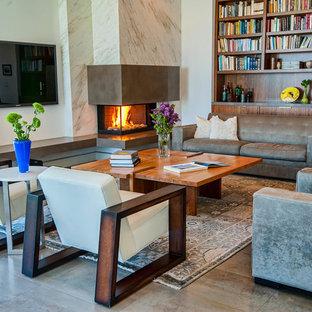 ロサンゼルスのコンテンポラリースタイルのおしゃれなリビング (コーナー設置型暖炉、グレーの床) の写真