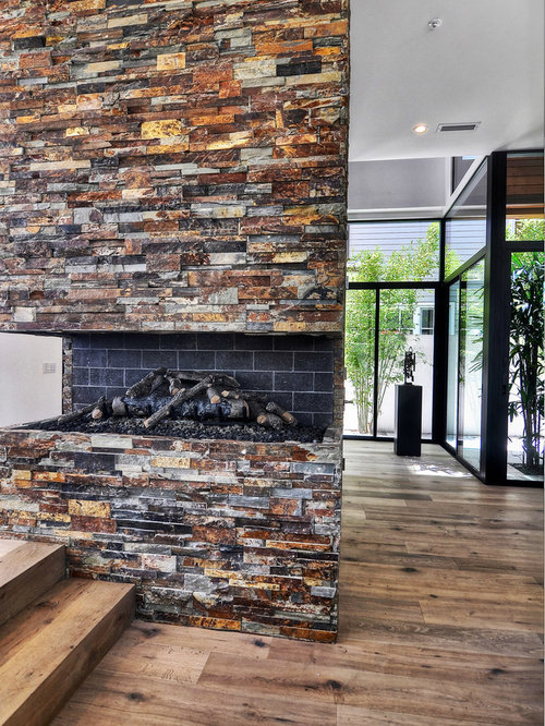 Browse 291 photos of Stacked Stone Fireplace. Find ideas and inspiration for Stacked Stone Fireplace to add to your own home.