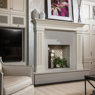 Inspiration for a large transitional dark wood floor family room remodel in Minneapolis with gray walls, a standard fireplace, a stone fireplace and a media wall