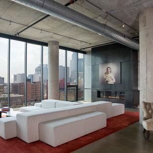 ミネアポリスの大きいインダストリアルスタイルのおしゃれなLDK (グレーの壁、コンクリートの床、横長型暖炉、コンクリートの暖炉まわり) の写真